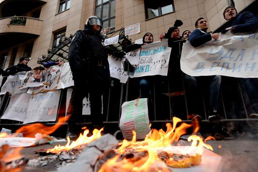 Protesters hold placards and shout slogans as they take part in an anti-Turkey picket outside the Turkish embassy in Moscow. Turkey shot down a Russian war plane on the Syrian border.