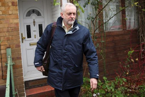 Britain's opposition Labour Party leader Jeremy Corbyn leaves in home in north London, Britain November 30, 2015