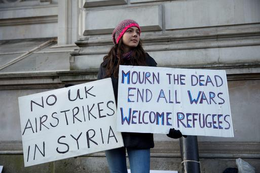 A peace protester outside Downing Street yesterday.