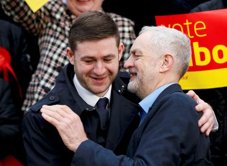 Jim McMahon (L), the newly elected member of Parliament for Oldham West and Royton for Britain's opposition Labour Party is congratulated by party leader Jeremy Corbyn.