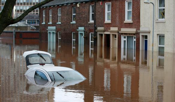 A car under flood waters in Carlisle yesterday. Photo: Reuters/Andrew Yates
