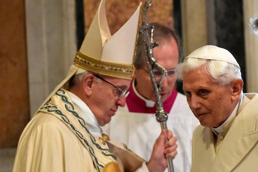 Pope Emeritus Benedict XVI (right) stands opposite Pope Francis in St Peter's Basilica in the Vatican before the opening of the 'Holy Door' to mark the start of the Jubilee Year of Mercy yesterday. Photo: Getty Images