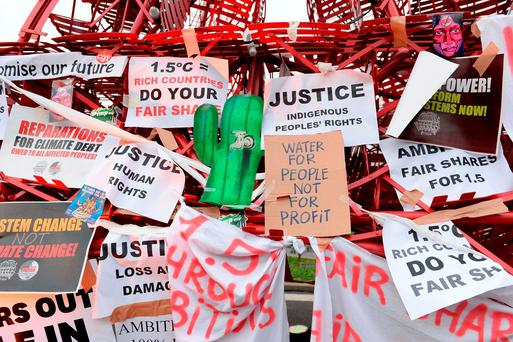 Banners with messages related to global warming attached to an Eiffel Tower made of bistro chairs at the venue of the United Nations conference on climate change COP21 in Paris