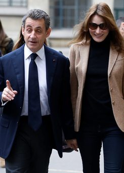 Former French President Nicolas Sarkozy and former French first lady Carla Bruni-Sarkozy arrive to cast their vote in Paris yesterday