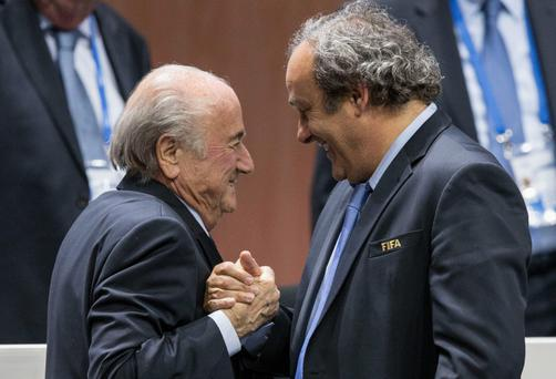 IFA president Sepp Blatter is greeted by UEFA President Michel Platini in May.