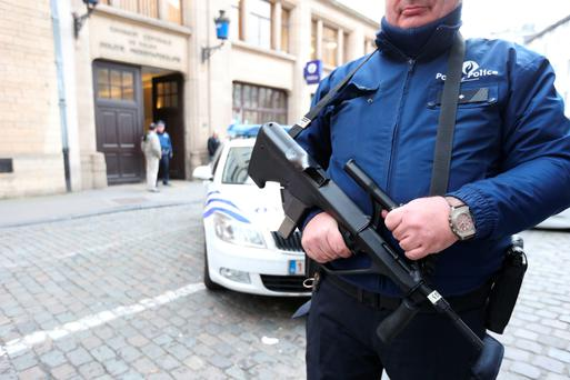 An armed policeman on the street in Brussels, where the terror alert has been lifted to Level 3 amid fears of a possible attack. Photo: AFP/Getty Images