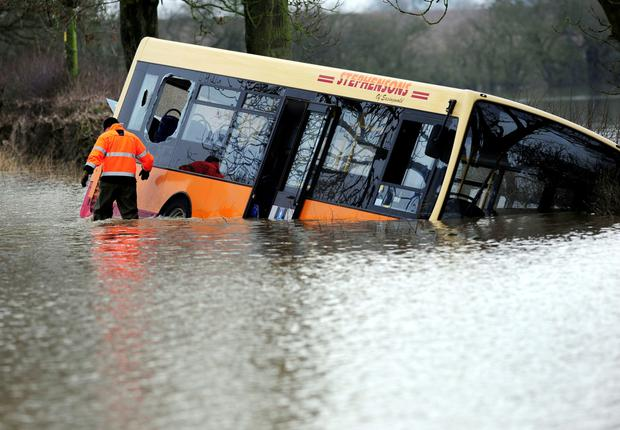 The school bus swept off the road by floodwater near Newton-on-Ouse, north of York in England