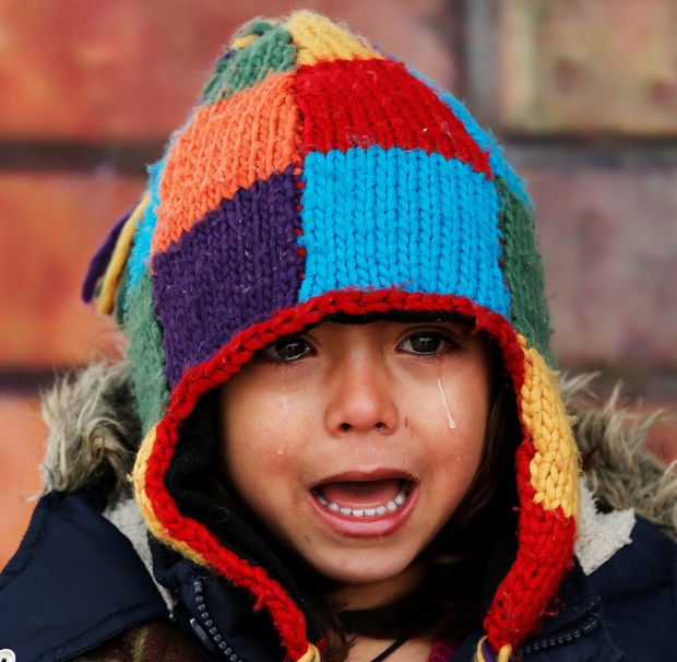 A child cries due to the cold at a registration camp for migrants in Presevo, Serbia Photo: Marko Djurica/Reuters