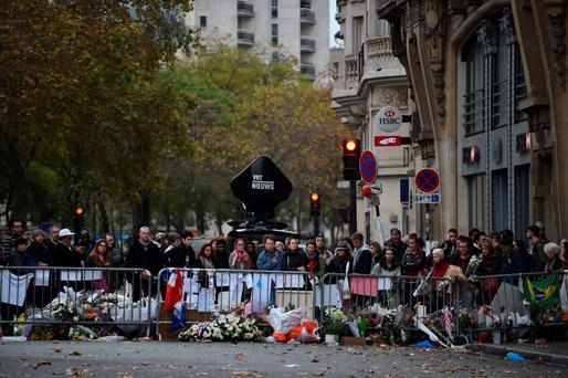 People gather at the scene at the Bataclan attack in Paris before Christmas.