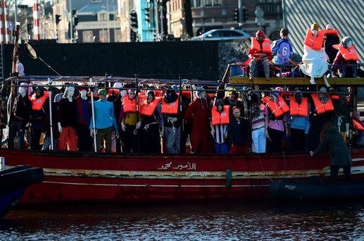 Amnesty activists protest in Amsterdam against the migrant crisis using a boat filled with mannequins wearing life jackets. Photo: AFP/Getty Images