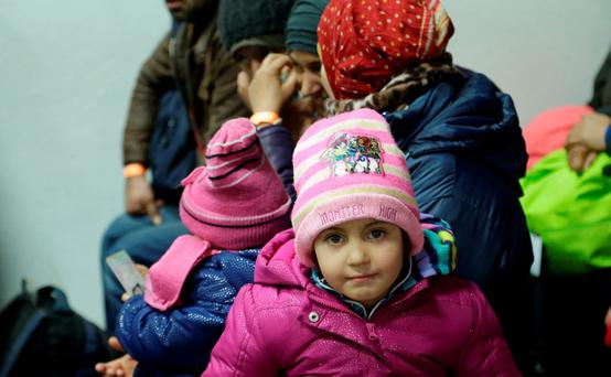 Migrants and refugees arriving from Austria wait to be registered at a processing center in Passau, Germany.
