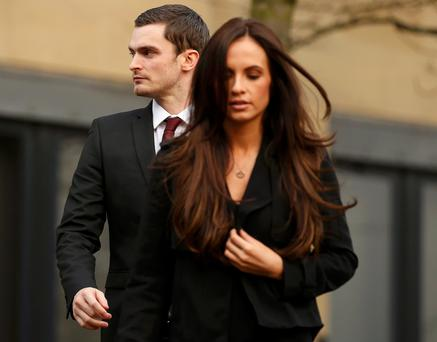 Former Sunderland soccer player Adam Johnson leaves with his girlfriend girlfriend Stacey Flounders from Bradford Crown Court in Bradford.