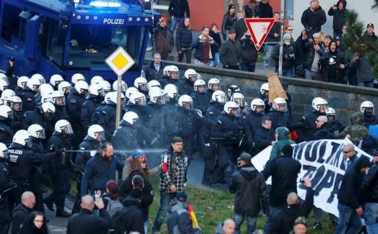 Police use pepper spray against supporters of anti-immigration right-wing movement Pegida after New Year's Eve, in Cologne. Photo: Reuters