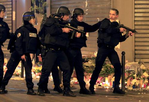 Police react to a suspicious vehicle near La Carillon restaurant following a series of deadly attacks in Paris.