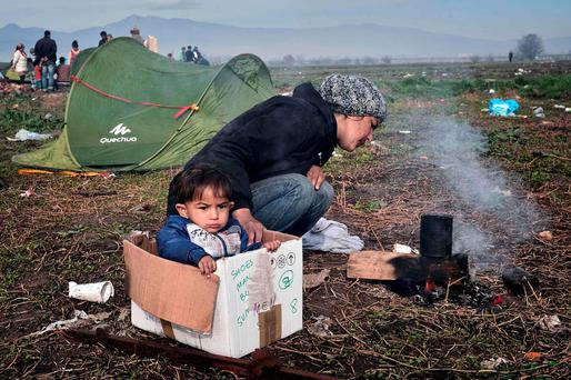 A mother and child at a camp near the Greek-Macedonian border. Picture: Getty Images