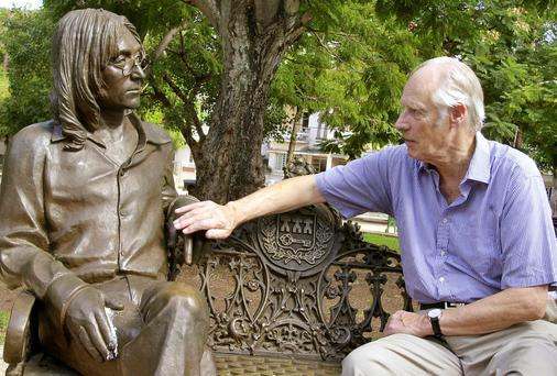 George Martin touches a statue of John Lennon in a park in the Vedado neighbourhood of Havana, during a visit to Cuba Photo: AP