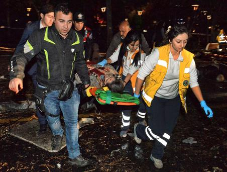 Emergency services help an injured victim after an explosion in Ankara's central Kizilay district