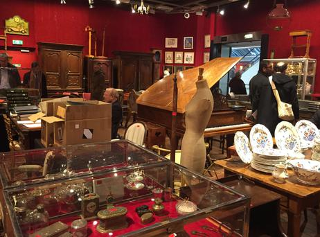 Visitors browse in a room of the Drouot auction house in Paris