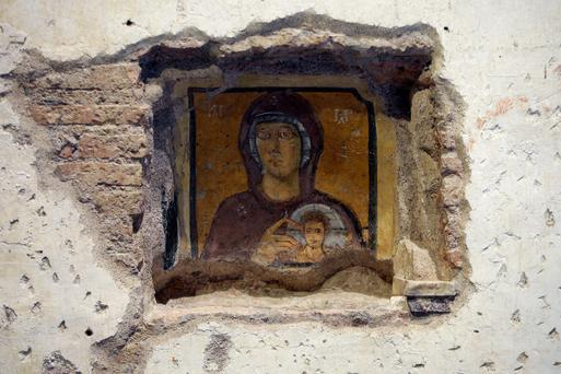 A fresco of the Virgin Mary and child in the Sixth Century Santa Maria Antiqua Church, Rome. The church was buried following an earthquake in AD847 and rediscovered in 1900. Photo: Reuters