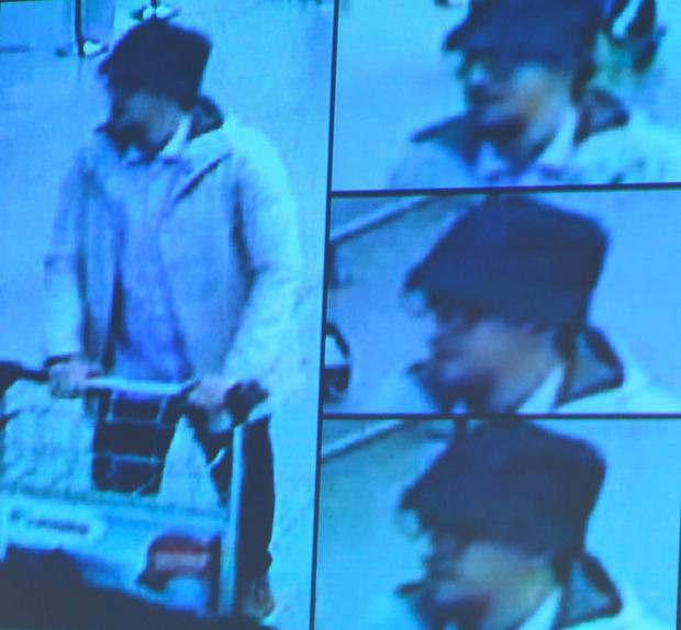 A photo taken during a press conference at the headquarters of the Federal Prosecutor in Brussels shows a scene from video footage showing the suspect pushing a cart at Brussels Airport just before the bomb attack. Photo: AFP/Getty Images