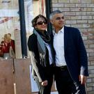 Sadiq Khan, Britain's Labour Party candidate for Mayor of London and his wife Saadiya pose for photographers after casting their votes for the London mayoral elections at a polling station in south London