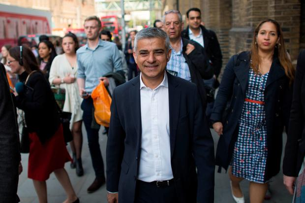 Mayor of London Sadiq Khan makes his way to City Hall from London Bridge Station in London, on his first day as mayor.