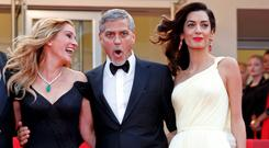 Cast members Julia Roberts, George Clooney and his wife Amal Alamuddin pose on the red carpet