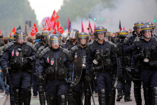 RIOT SQUAD: French police march at a protest in Paris against a new labour law, forced through parliament without a vote by the socialist government. Photo: Christophe Ena/AP