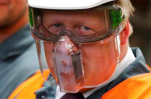 Former mayor of London and Vote Leave campaigner Boris Johnson wears protective equipment as he visits Reid Steel during a campaign stop in Christchurch. Photo: Reuters