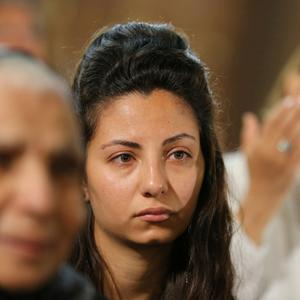 Relatives of the Christian victims of the crashed EgyptAir flight MS 804 react during an absentee funeral mass at the main Cathedral in Cairo, Egypt,