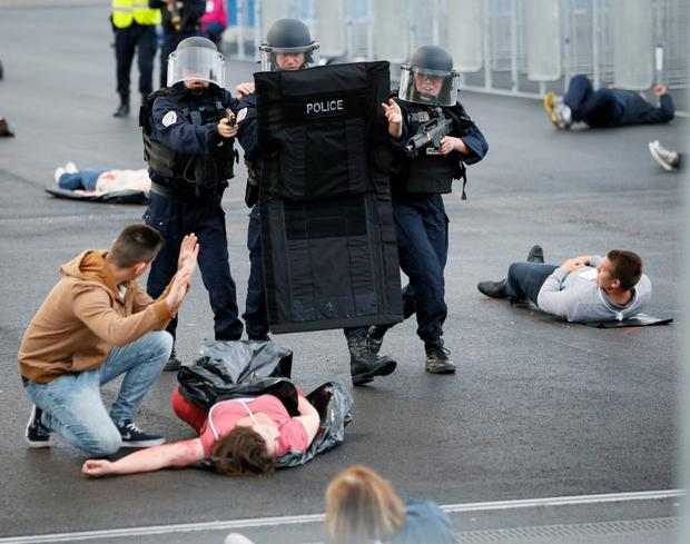 French police take part in a mock attack drill outside the Grand Stade stadium in Decines, near Lyon, France, in preparation of security measures for the Euro 2016 soccer tournament. Photo: Reuters/Robert Pratta