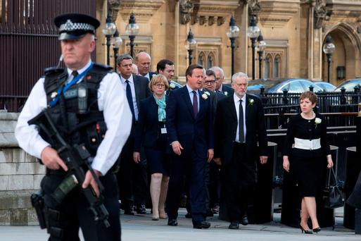 British PM David Cameron alongside Labour leader Jeremy Corbyn as they leave Parliament to attend a service of remembrance for Jo Cox in London yesterday. Photo: Getty