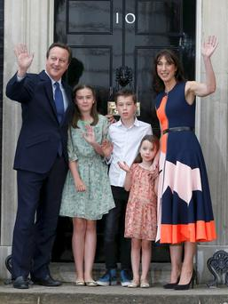 David Cameron and wife Samantha, daughters Nancy (left) and Florence and son Elwen wave goodbye to 10 Downing Street Photo: Reuters