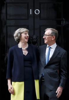 New British prime minister Theresa May with her husband Philip outside 10 Downing Street yesterday. Photo: Reuters