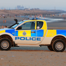 Police on Camber Sands near Rye, East Sussex, after five men died on the hottest day of the year. Photo: Gareth Fuller/PA