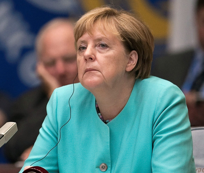 Angela Merkel: says decisions over migrant crisis were right. Photo: Reuters