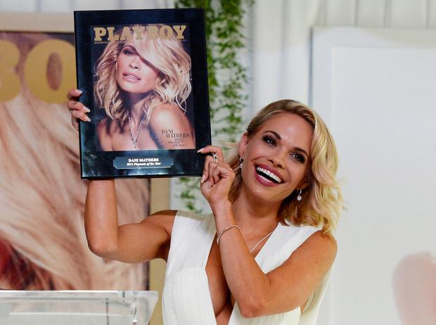 Dani Mathers pictured holding a plaque with the cover of the 'Playboy' June 2015 issue, in which she was named 2015 Playmate of the Year. Photo: Reuters