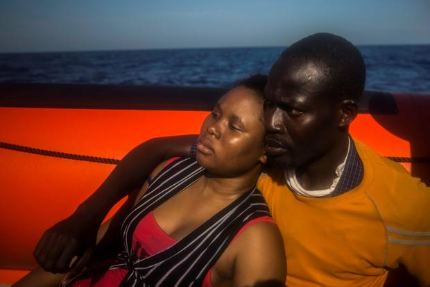 A woman and a man from Niger rest, aboard a rescue boat from the Spanish NGO Proactiva Open Arms, after they fell into the water from the rubber boat in which they were traveling in, with other refugees and migrants, on the Mediterranean Sea, about 18 miles North of Sabratha, Libya.