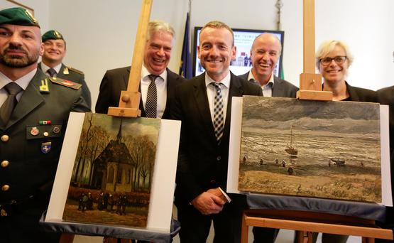 Director of Amsterdam's Van Gogh Museum Axel Ruger (C) poses next to paintings by the Dutch artist Vincent Van Gogh, that was stolen in Amsterdam 14 years ago, during a news conference in Naples