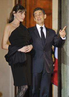 Former French president Nicolas Sarkozy and his wife Carla