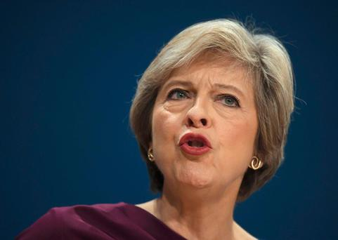 British Prime Minister Theresa May delivers her speech on the final day of the annual Conservative Party Conference in Birmingham yesterday. Photo: Reuters