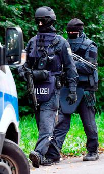 Police walk near an apartment building in the Yorck area of Chemnitz, eastern Germany. Photo: PA