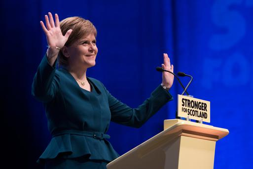 First Minister of Scotland and SNP leader Nicola Sturgeon speaks as the SNP's biggest-ever conference began in Glasgow. Photo: John Linton/PA