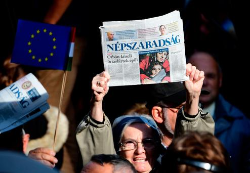 Journalists of Hungary's biggest opposition newspaper Nepszabadsag and their supporters protest in Budapest. GETTY