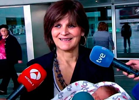 Lina Alvarez leaves Lucas Augusti Hospital with her new born baby, in Madrid, Spain.Photo: AP
