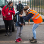 A migrant child is put on a bus by Calais careworkers Photo: Getty