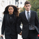 Ched Evans leaves Cardiff Crown Court with partner Natasha Massey after being found not guilty of rape. GETTY
