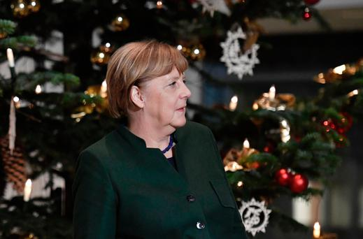 German Chancellor Angela Merkel standing in front of the newly erected Christmas tree at the Chancellory in Berlin. Photo: AFP/Getty Images