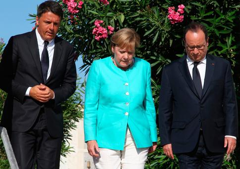 Italian Prime Minister Matteo Renzi (left), German Chancellor Angela Merkel and French President Francois Hollande on the island of Ventotene in August during a meeting to discuss the post-Brexit EU. Mr Renzi has since suffered a ruinous referendum defeat Photo: Carlo Hermann/Getty Images