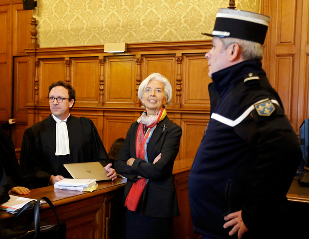IMF chief Christine Lagarde speaks to her legal team before the start of her trial in Paris. Photo: Reuters